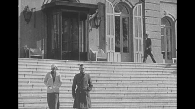 Jimmy Walker and Betty Compton descend stairs walk past camera / Note exact year not known documentation incomplete