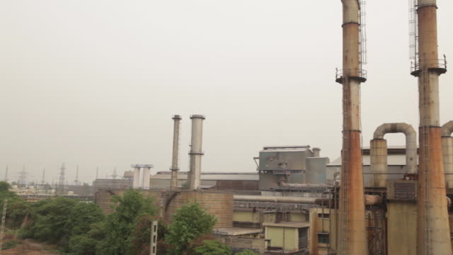 jindal stainless hisar stainless steel factory exterior views from the flyover views include power generation unit and melting shop views in hisar... - metal blend stock videos and b-roll footage