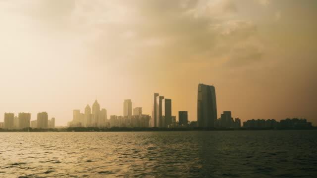 WSJinji Lake and skyline of Suzhou with Gate to the East at sunset, Jiangsu Province, China