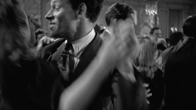 jitterbug dancers fill a dance floor. - couple relationship stock videos & royalty-free footage