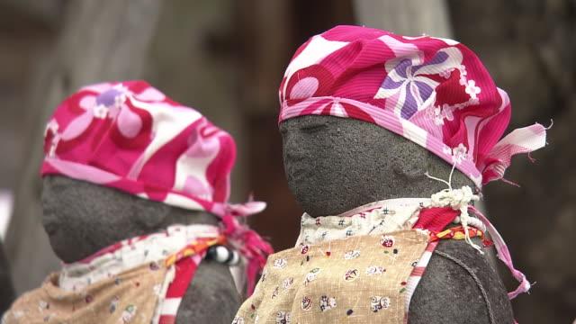 cu, jizo statues in snow, fukushima, japan - memorial event stock videos & royalty-free footage