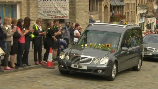 jo cox funeral; england: yorkshire: ext funeral cortege of murdered mp jo cox along as people applaud and place flowers on the hearse people lining... - mp stock videos & royalty-free footage