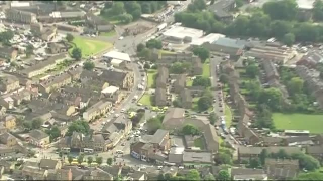 aerials england west yorkshire birstall house of suspect tommy mair with forensic police in garden / crime scene where jo cox was attacked - thomas mair stock videos and b-roll footage