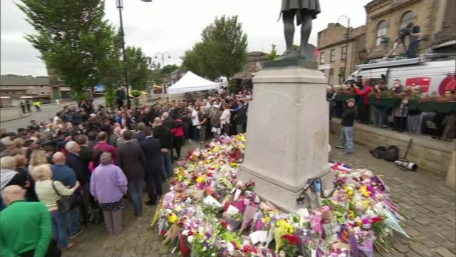 court told of mp's final moments t18061601 / tx wide shot of people gathered around mass of floral tributes to jo cox laid around statue - jo cox politician stock videos and b-roll footage