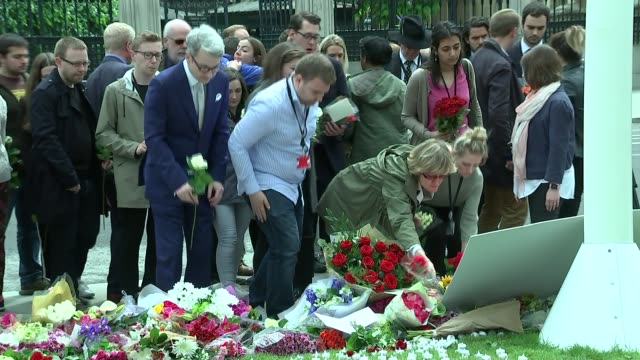 family pay tribute / thomas mair appears in court london floral tributes pan woman looking on people laying floral tributes woman wiping away tears... - thomas mair stock videos and b-roll footage