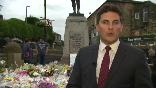 fundraising effort passes three quarters of a million pounds floral tributes reporter to camera women laying flowers woman looking at floral tributes... - murder stock videos & royalty-free footage