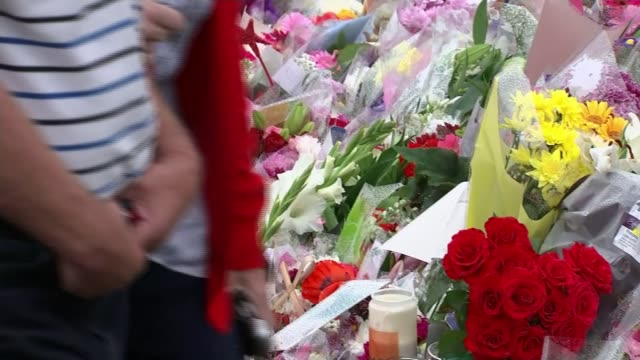 parliament recalled to pay tribute; yorkshire: birstall: ext various of flowers being placed with others laid in memory of jo cox in her constituency... - baroness stock videos & royalty-free footage