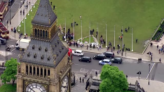 procession aerials AIR VIEWS Victoria Tower with flag at half mast and Houses of Parliament / Procession along past Westminster Abbey and into St...