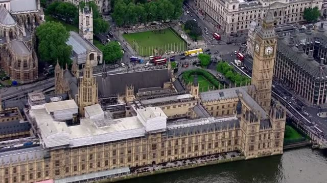 procession aerials ENGLAND London Westminster Victoria Tower with flag at half mast and Houses of Parliament / Jo Cox shrine in Parliament square /...