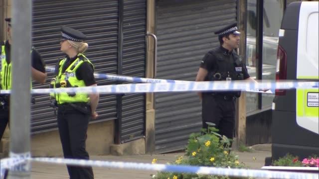 vox pops; crime scene with police tape / birstall car park / police - jo cox politikerin stock-videos und b-roll-filmmaterial
