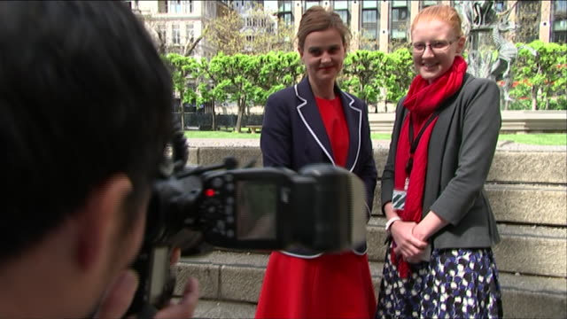 jo cox poses for photographs during her first day as a newly elected labour mp - jo cox politician stock videos and b-roll footage