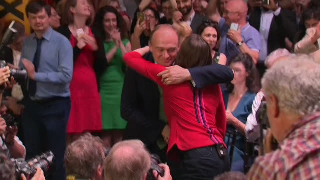 jo swinson announced new leader of the liberal democrats at leadership rally receives hug from rival sir ed davey - british liberal democratic party stock videos & royalty-free footage