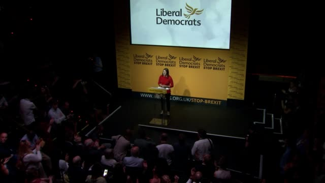 jo swinson elected new leader of liberal democrats; england: london: westminster: int high angle view of jo swinson mp on stage zoom in - british liberal democratic party stock videos & royalty-free footage