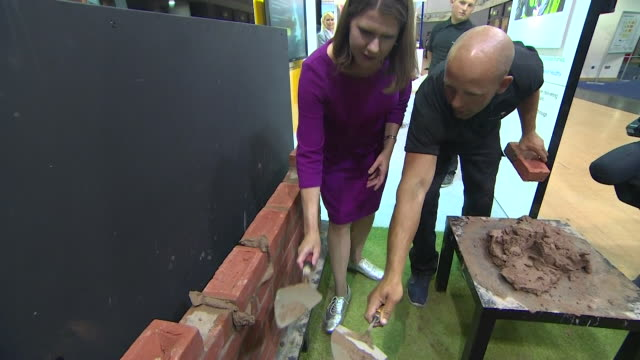jo swinson liberal democrat leader tries bricklaying at party conference in bournemouth - brick stock videos & royalty-free footage