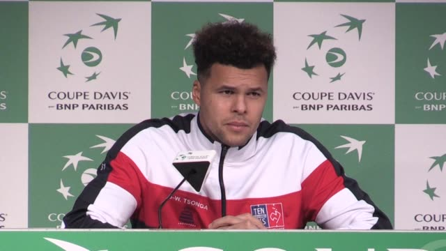 jo wilfried tsonga pulled france level at 11 in the davis cup final with an assured three set win over belgium's steve darcis in lille on friday - davis cup stock videos & royalty-free footage