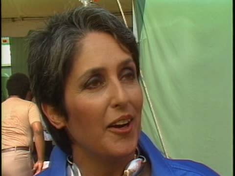joan baez says that the live aid concert is meant to inspire people during a backstage interview at the event. - music or celebrities or fashion or film industry or film premiere or youth culture or novelty item or vacations stock videos & royalty-free footage