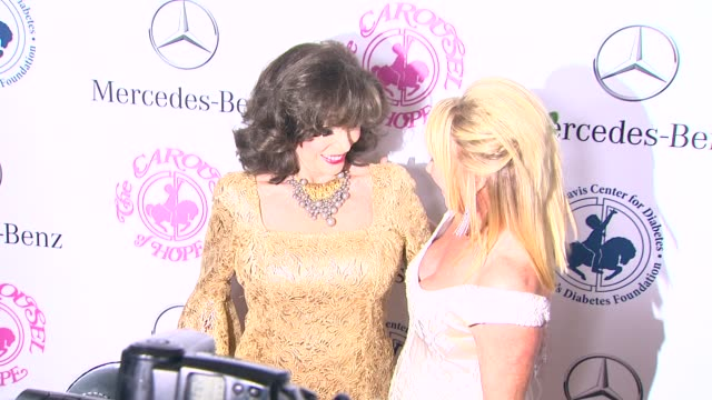joan collins and suzanne somers at the 2014 carousel of hope ball at the beverly hilton hotel on october 11 2014 in beverly hills california - suzanne somers stock videos & royalty-free footage