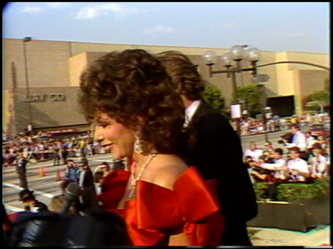joan collins at the 1987 emmy awards with stuart pankin at the pasadena civic auditorium in pasadena, california on september 20, 1987. - 1987 stock videos & royalty-free footage