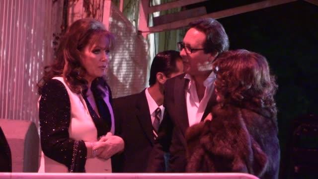 vídeos y material grabado en eventos de stock de joan collins & jackie collins depart the 2013 vanity fair oscar party in west hollywood, 02/24/13 - oscar party