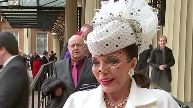 joan collins receives damehood at buckingham palace; dame joan collins interview sot - most people will still call me joan/ dame joan collins posing... - husband stock videos & royalty-free footage
