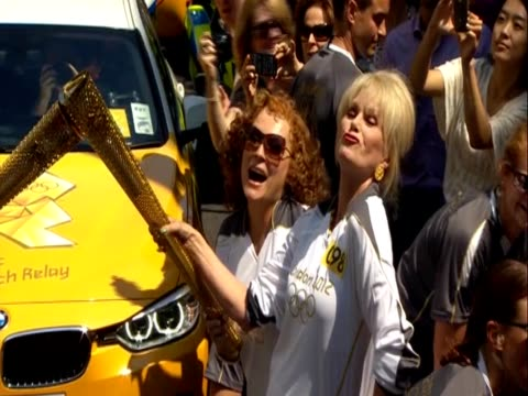 joanna lumley and jennifer saunders pose with the olympic torch - jennifer saunders stock videos & royalty-free footage
