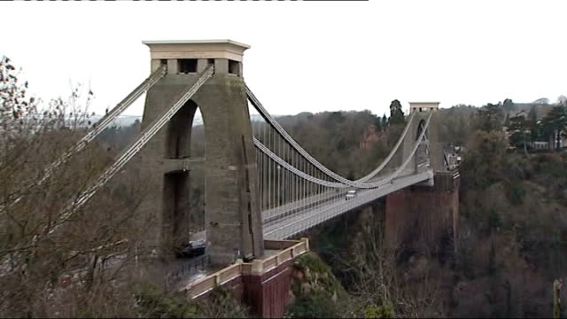 Clifton suspension bridge and body site View over bridge and Avon gorge / police officer and car blocking access to lane where the body of Joanna...