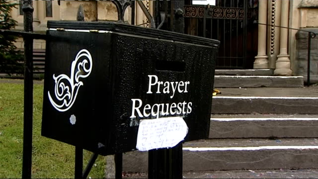 Flowers laid outside flat/prayer vigil at church Prayer Requests box attached to railings of local church / message for Joanna Yeates attached to...