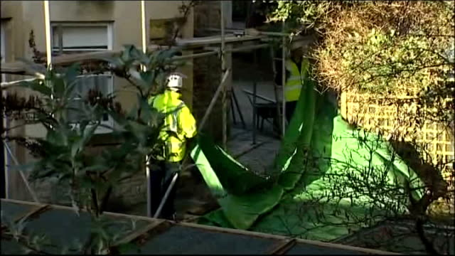 man arrested Workman erecting scaffolding around building where Joanna Yeates lived Two men putting up green tarpaulin tent Reporter to camera