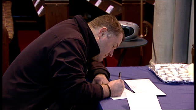memorial service on first anniversary of her death england bristol clifton candle on table and man writing memorial card behind side shot man writing... - card table stock videos & royalty-free footage