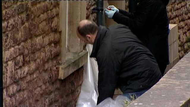 Police investigation continues Flat door removed People outside door of flat / building housing flat / people working to remove front door of flat /...