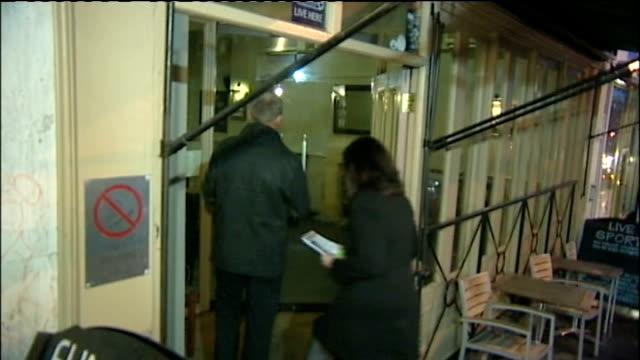 police investigation continues; police detectives along to bristol ram pub to hand out appeal leaflets ends bristol ram pub int police appeal poster... - イングランド南西部点の映像素材/bロール
