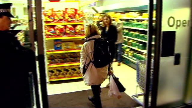 police stage reconstruction ENGLAND Bristol Filming of 'Crimewatch' programme featuring RECONSTRUCTION of Joanna Yeates buying pizza from Tesco store...