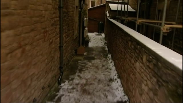 Vincent Tabak trial DATE Snow on ground outside flat where Joanna Yeates lived TRACK FORWARD to front door