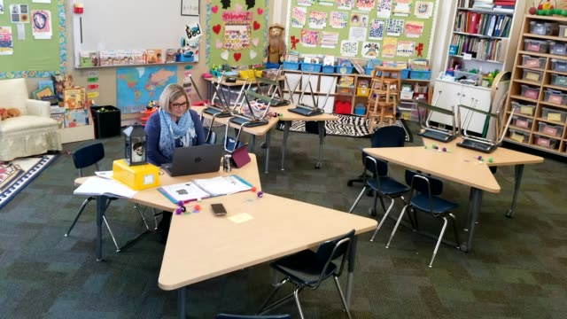 joanne collins brock, a second grade teacher at st francis school , teaches online in her empty classroom on april 15, 2020 in goshen, kentucky.... - teacher stock videos & royalty-free footage
