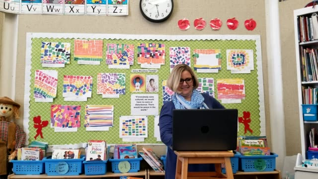 joanne collins brock a second grade teacher at st francis school teaches online in her empty classroom on april 15 2020 in goshen kentucky brock has... - teaching stock videos & royalty-free footage