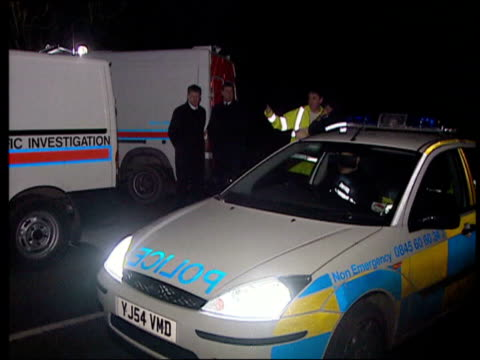 body discovered/boyfriend charged; england: north yorkshire: nr malton: brandsby: ext/night police officers chatting near woodlands where body of... - road closed sign stock videos & royalty-free footage