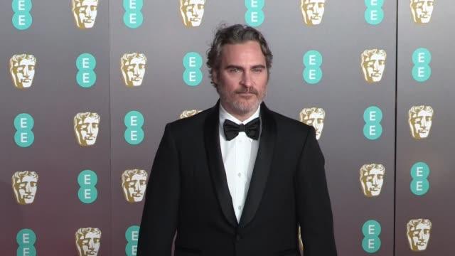 joaquin phoenix at the photocall for the 70th ee british academy film awards bafta in london london, uk on sunday february 2nd 2020 - ホアキン・フェニックス点の映像素材/bロール