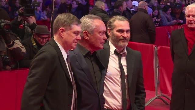 Joaquin Phoenix Gus Van Sant and Udo Kier walk the red carpet for the Berlin film festival screening of Don't worry he won't get far on foot