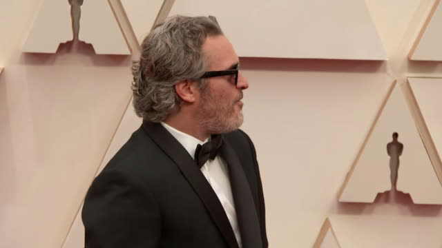 joaquin phoenix walking the red carpet at the 92nd annual academy awards at the dolby theater in los angeles, california. - music or celebrities or fashion or film industry or film premiere or youth culture or novelty item or vacations 個影片檔及 b 捲影像