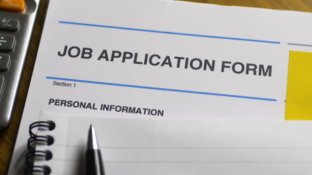 job application form close-up. pan l to r. - interview event stock videos & royalty-free footage
