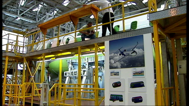 Job cuts at Bombardier aircraft parts factory and Aviva NORTHERN IRELAND Belfast INT General views of people at work inside Bombardier aircraft parts...