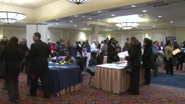 job fair / job seeking / employment / unemployment / resume / recruitment / job new york city job fair at hotel conference ball room on february 06,... - 就職フェア点の映像素材/bロール
