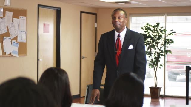 MS, Job fair leader talking to group in unemployment office, Phoenix, Arizona, USA