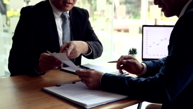 job interviewers are pointing to the resume in the employee resume document and talking about the work experience of the employee. - candidate stock videos & royalty-free footage