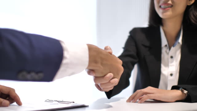 job interviewing, appointment and handshake - giving stock videos & royalty-free footage