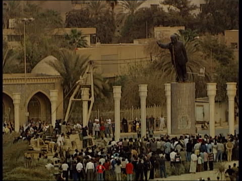 job losses in wake of conflict itn statue of saddam hussein toppled - saddam hussein stock videos & royalty-free footage