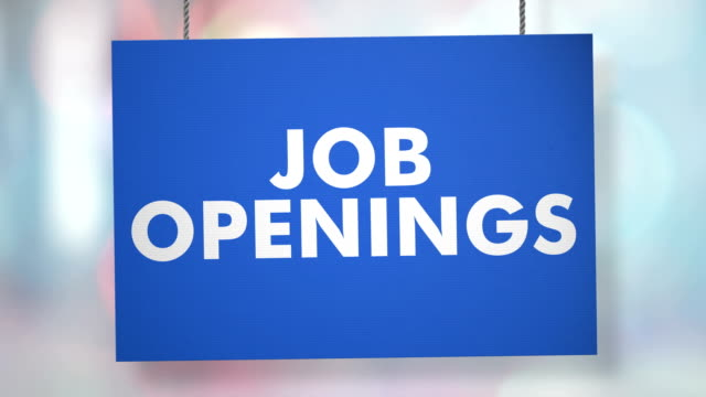 job openings hiring sign hanging from ropes. luma matte included so you can put your own background. - pendere video stock e b–roll