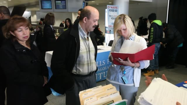 A job seeker fills out a McDonald's Corp job application at a job fair for concession employment opportunities in International Terminal 5 at O'Hare...