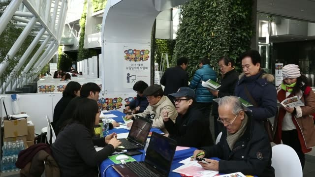 a job seeker right talks to a recruiter during a job fair organized by the seoul metropolitan government at seoul city hall in seoul south korea on... - unemployment application stock videos & royalty-free footage