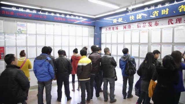 MS PAN Job seeker seeing recruitment informations at employment Fair / xi'an, shaanxi, china